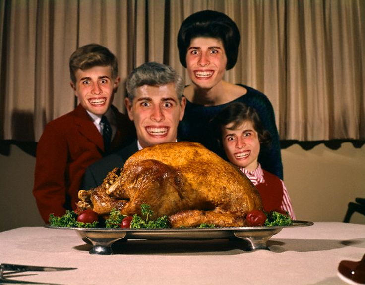 25 Oct 1961 --- 1960s Portrait Of Family Looking At Thanksgiving Or Christmas Roast Turkey --- Image by © H. Armstrong Roberts/ClassicStock/Corbis